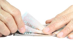 Cuenta el dinero Imágenes de archivo libres de regalías