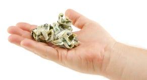 Cuentas de dólar arrugadas en palma Imagen de archivo libre de regalías