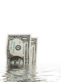 Cuentas de dólar en agua Fotografía de archivo