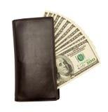 Cuentas de dólar los E.E.U.U. en el monedero de cuero Foto de archivo libre de regalías
