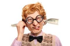 Cuentas de dólar que salen de mis oídos Imágenes de archivo libres de regalías