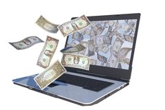 Cuentas de dólar que vuelan hacia fuera el ordenador portátil Imagen de archivo
