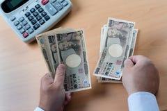 Cuentas de los Yenes japoneses Foto de archivo libre de regalías