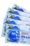 Cuentas de moneda del dólar de Hong Kong aisladas en blanco Fotos de archivo libres de regalías