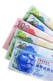 Cuentas de moneda del dinero del dólar de Hong Kong aisladas en el fondo blanco Fotos de archivo