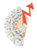 cuentas del Ciento-dólar y una flecha roja Fotos de archivo