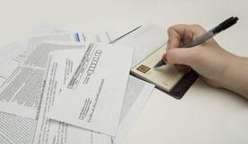 Cuentas que pagan Foto de archivo libre de regalías