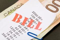 Cuentas y dólares canadienses Fotos de archivo libres de regalías