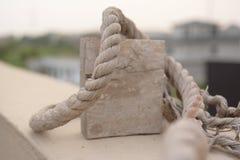 Cuerda alrededor de la madera Imagen de archivo
