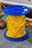 Cuerda amarilla en el carrete Imagen de archivo libre de regalías