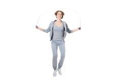 Cuerda de salto deportiva de la mujer Imagen de archivo libre de regalías