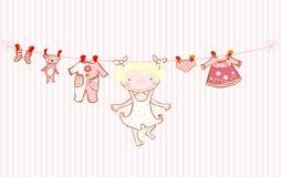 Cuerda para tender la ropa de la tarjeta del aviso de la llegada del bebé Imagen de archivo