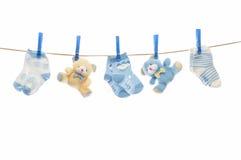 Cuerda para tender la ropa del niño Fotos de archivo libres de regalías