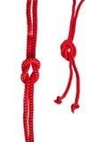 Cuerda roja con el nudo fotos de archivo