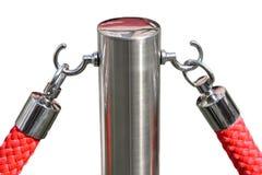Cuerda roja del terciopelo y un poste de plata Foto de archivo libre de regalías