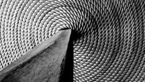 Cuerdas espirales con un zanco de madera Fotos de archivo libres de regalías