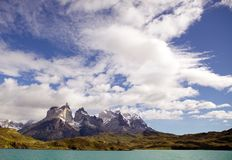 Cuernos del Paine view from Lake Pehoe in Torres del Paine National Park, Magallanes Region, southern Chile. Cuernos del Paine with blue sky and clouds, view royalty free stock image