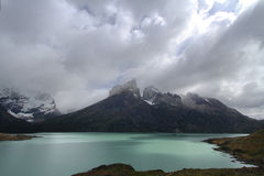 Cuernos del Paine and turquoise lake. Just a ray of sun on the mirador de Cuernos del Paine over a turquoise lake stock photography