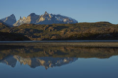 Cuernos del Paine in Torres del Paine National Park, Chile. Mountain peaks of Cuernos del Paine rising above the southern end of Lago Grey in Torres del Paine stock image