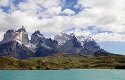 Cuernos del Paine view from Lake Pehoe in Torres del Paine National Park, Magallanes Region, southern Chile. Cuernos del Paine with typical Patagonian weather stock photos
