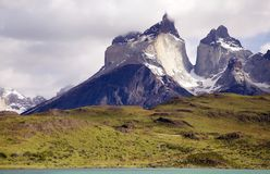 Cuernos del Paine view from Lake Pehoe in Torres del Paine National Park, Magallanes Region, southern Chile. Cuernos del Paine with typical Patagonian weather stock photo