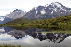 Cuernos del Paine in Torres del Paine National Park, Magallanes Region, southern Chile. Cuernos del Paine which are reflected in the lake in Torres del Paine royalty free stock image