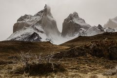 The Cuernos moutains in Torres Del Paine in Patagonia. The Cuernos in the dramatic landscape of Patagonia in the Torres Del Paine National Park in Chile royalty free stock photos