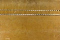 Cuero amarillo con las puntadas blancas Imágenes de archivo libres de regalías