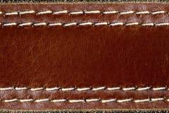 Cuero de Brown con el fondo de la costura. Foto de archivo libre de regalías