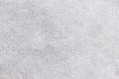 Cuero suave del ante gris claro como fondo de la textura Ciérrese encima del le Foto de archivo