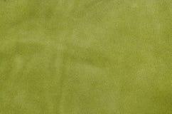 Cuero suave del ante verde como fondo de la textura Ciérrese encima del cuero Imagenes de archivo