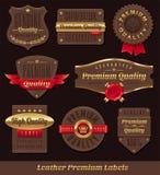 Cuero y escrituras de la etiqueta del premio y de la calidad del oro