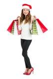 Cuerpo completo de la mujer de las compras de la feliz Navidad Imagen de archivo