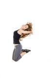 Cuerpo completo del salto bonito joven alegre de la muchacha o de la mujer del ajuste Foto de archivo