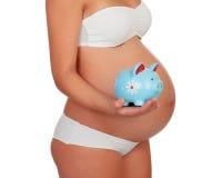 Cuerpo embarazada en ropa interior con el moneybox foto de archivo