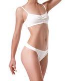 Cuerpo femenino delgado del ajuste sano hermoso en el fondo blanco Fotografía de archivo libre de regalías