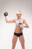 Cuerpo muscular de una chica joven Fotos de archivo libres de regalías
