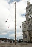 CUETZALAN, MEXICO - 2012: A family of acrobats known as `los voladores` perform in the Cuetzalan zocalo Stock Photos