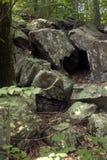 Cueva en rocas Foto de archivo