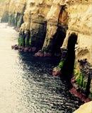 Cuevas en la playa Imagenes de archivo
