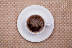Cuf of coffee. On bamboo weave Stock Image