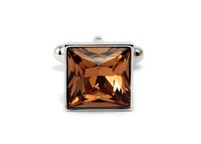 Cuff link. Silver cuff link with brown crystal stock images