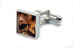 Cuff link. Silver cuff link with brown crystal royalty free stock photography