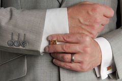Cuff link Adjustment Royalty Free Stock Image