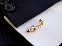 Cuff link in the form of the Ancient knife Stock Photos