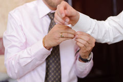 Cuff Link on Groom's Sleeve Stock Images