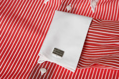 Cuff link on men's red shirt. Close-up of cuff link on men red shirt Royalty Free Stock Image