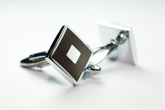 Cuff links. Isolated by white background stock photo