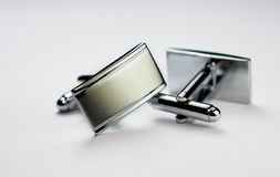 Cuff links. Isolated by white background stock image