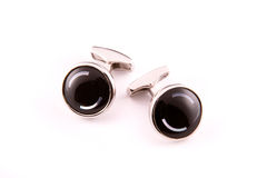 Cuff links. Black little Cuff links. Isolated stock photos